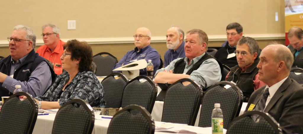 This image has an empty alt attribute; its file name is MCOC-59TH-Annual-Meeting-Audience-1024x453.jpg